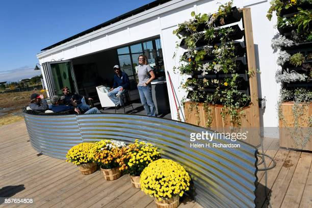 DENVER CO OCTOBER 3 Students from the Missouri University of Science and Technology relax in their almost completed house in preparation for the US...