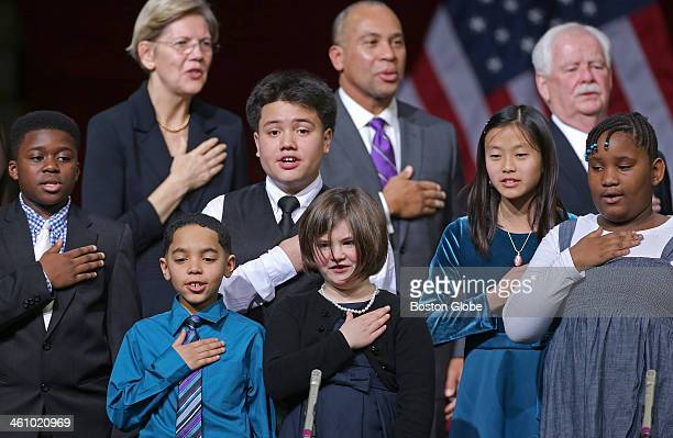 Students from the Neighborhood House Charter School say the Pledge of Allegiance at the the inauguration ceremony for Mayorelect Marty Walsh at...