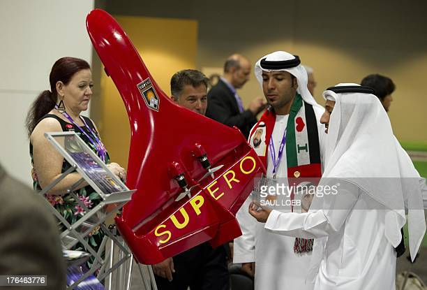 Students from the United Arab Emirates view an Unmanned Aerial Vehicle or drone by Supero during the Unmanned Systems 2013 exhibition and symposium...