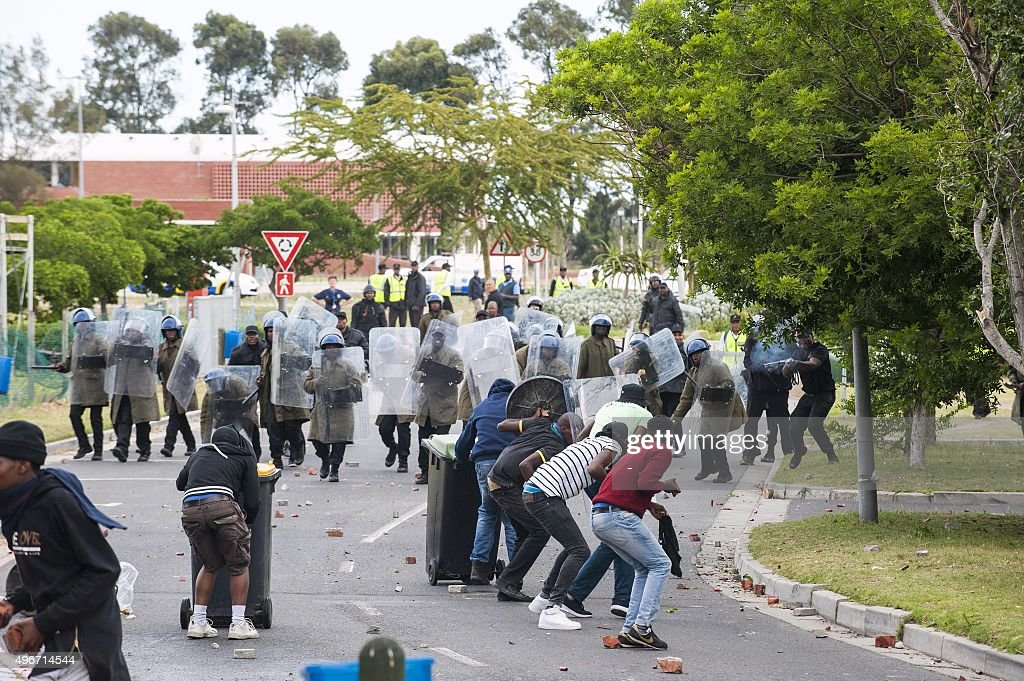 Students from the University of Western Cape and protesters clash with South African police during a demonstration in Cape Town on November 11 2015...