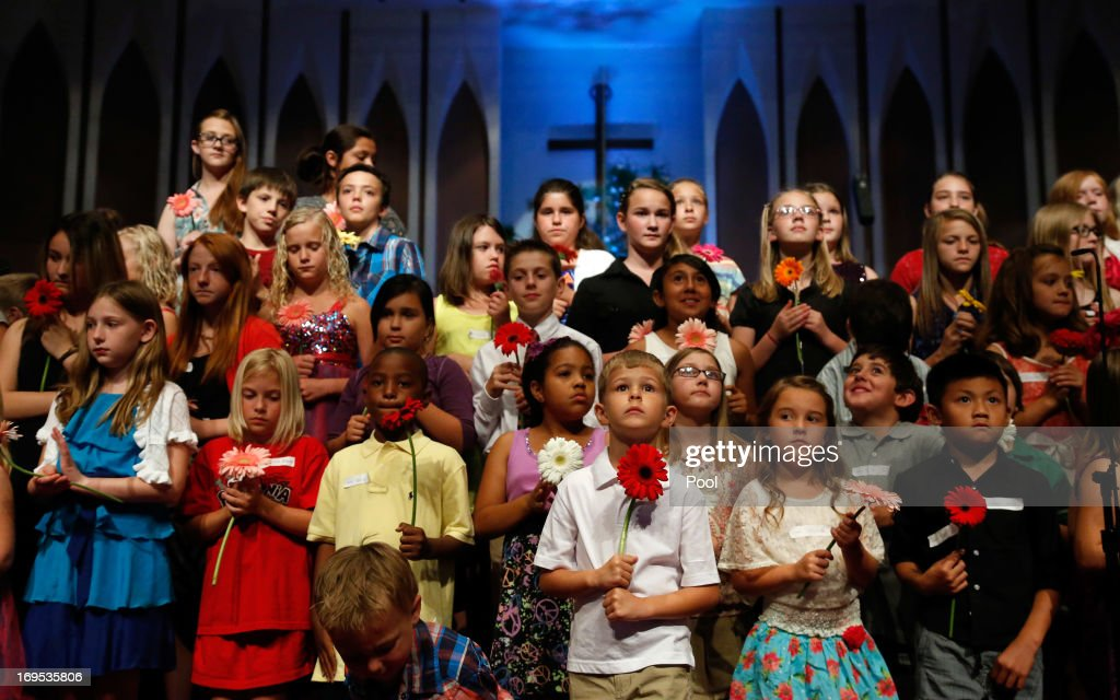 Students from various Moore elementary schools stand on stage during the Oklahoma Strong memorial service held to honor victims of the recent deadly tornado at the First Baptist Church on May 26, 2013 in Moore, Oklahoma. The tornado of EF5 strength and two miles wide touched down May 20 killing at least 24 people and leaving behind extensive damage to homes and businesses. U.S. President Barack Obama visited the area Sunday and promised federal aid to supplement state and local recovery efforts.