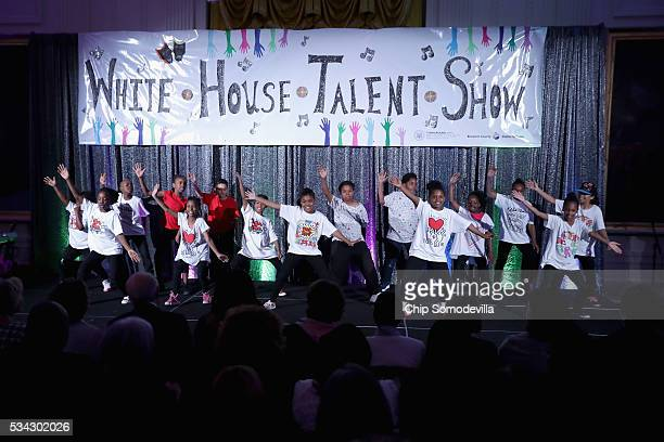 Students from Washington DC pefrorm during the White House Turnaround Arts Talent Show in the East Room at the White House May 25 2016 in Washington...