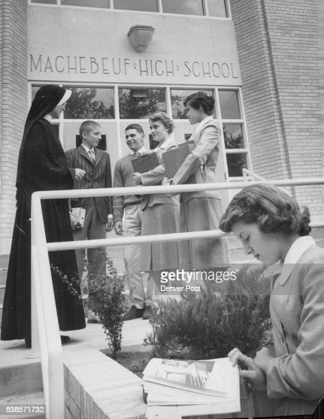 Students gather at the entrance of new Machebeuf High School with the principal Sister Mary Thomasine In front is Anita Howe of 1260 Pontiac St With...
