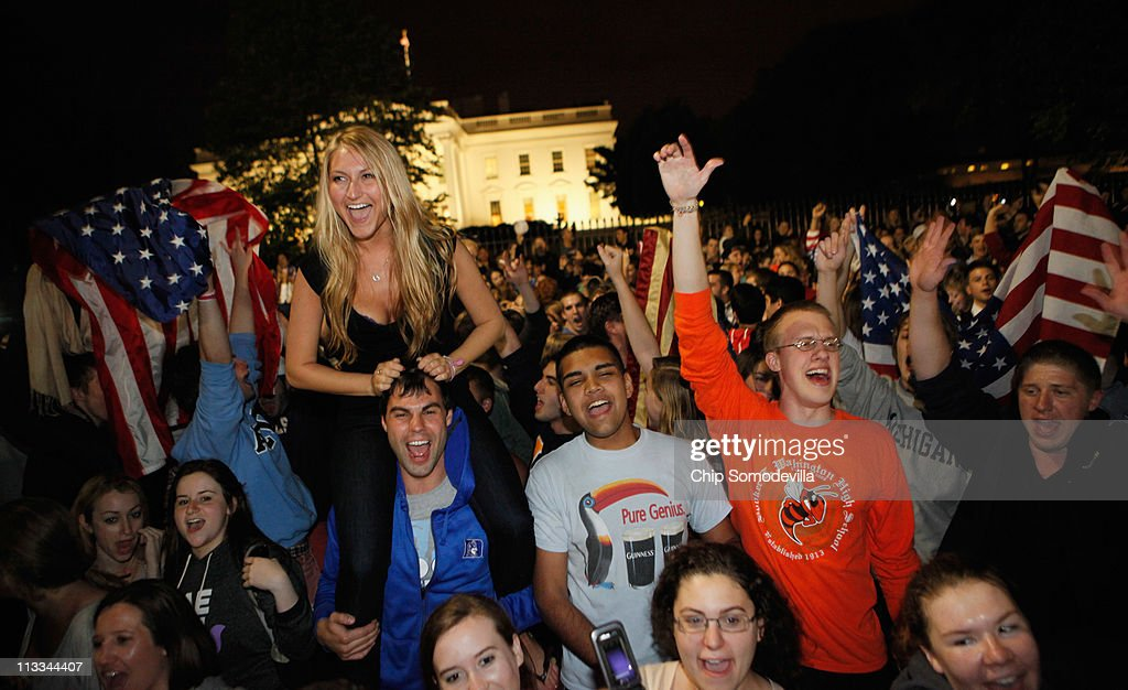 Students gather at the fence on the north side of the White House, pose for photographs, chant 'U.S.A.! U.S.A.!' and sing the Star Spangled Banner while U.S. President Barack Obama announces the death of Osama Bin Laden during a late evening statement to the press in the East Room of the White House May 1, 2011 in Washington, DC. Bin Laden has been killed near Islamabad, Pakistan almost a decade after the terrorist attacks of Sept. 11, 2001 and his body is in possession of the United States.