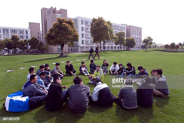 Students gather in a circle on the campus of Shanghai University of Engineering Science in the outskirts on April 7 2010 in Shanghai China