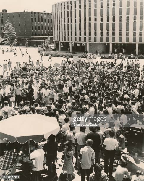 Students gather in a large group during a student strike to protest against the Vietnam War and US actions in Cambodia some wearing hippie attire and...