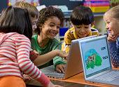 Students gathered around laptops
