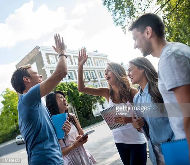 Students giving a high-five