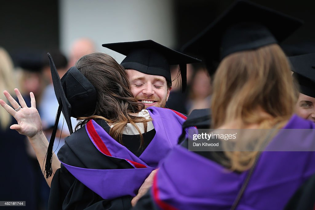 Students greet each other ahead of their graduation ceremony at the Royal Festival Hall on July 15, 2014 in London, England. Students of the London College of Fashion, Management and Science and Media and Communication attended their graduation ceremony at the Royal Festival Hall today.