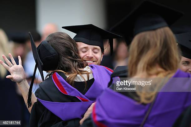 Students greet each other ahead of their graduation ceremony at the Royal Festival Hall on July 15 2014 in London England Students of the London...
