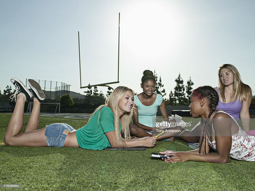 students hanging out at sports field picture id175280934