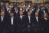 Students have their official class photograph taken after graduating from Oxford University UK October 1988