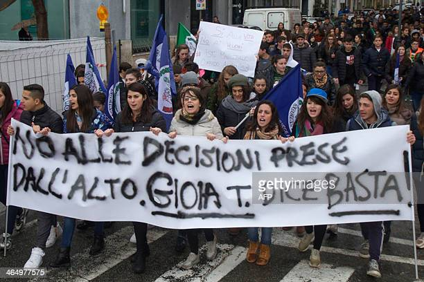 Students hold a banner reading 'No to decisions taken from above Gioia tells you Enough ' during a rally in Gioia Tauro southern Italy to protest...