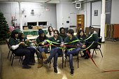 Students hold a colored ribbon December 14 2011 with each inch representing $1 billion USD for as part of the US military budget spent in Iraq and...