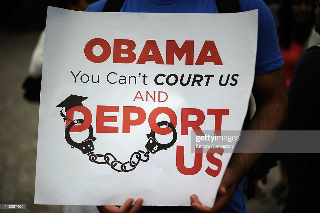 Students hold a sign during a demonstration by immigrant student for an end to deportations and urge relief by governmental agencies for those in deportation proceedings on June 15, 2012 in Los Angeles, California. In a policy change, the Obama administration said it will stop deporting young illegal immigrants who entered the United States as children if they meet certain requirements.