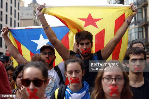 Students hold a silent protest against the violence that marred yesterday's referendum vote outside the University on October 2 2017 in Barcelona...