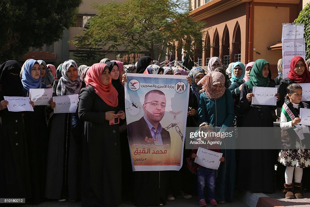 Students hold banners during a protest for release of journalist Muhammed el-Kayk, who stages a hunger strike in an Israeli prison, at Islamic University of Gaza on February 14, 2016, in Gaza City, Gaza.
