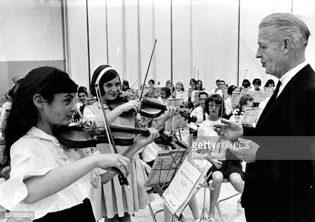Students Hold Festival No2 John T Roberts right music director for Denver Public Schools helps violinists Naomi Kaplan 773 S Ivy St left and Peggy...