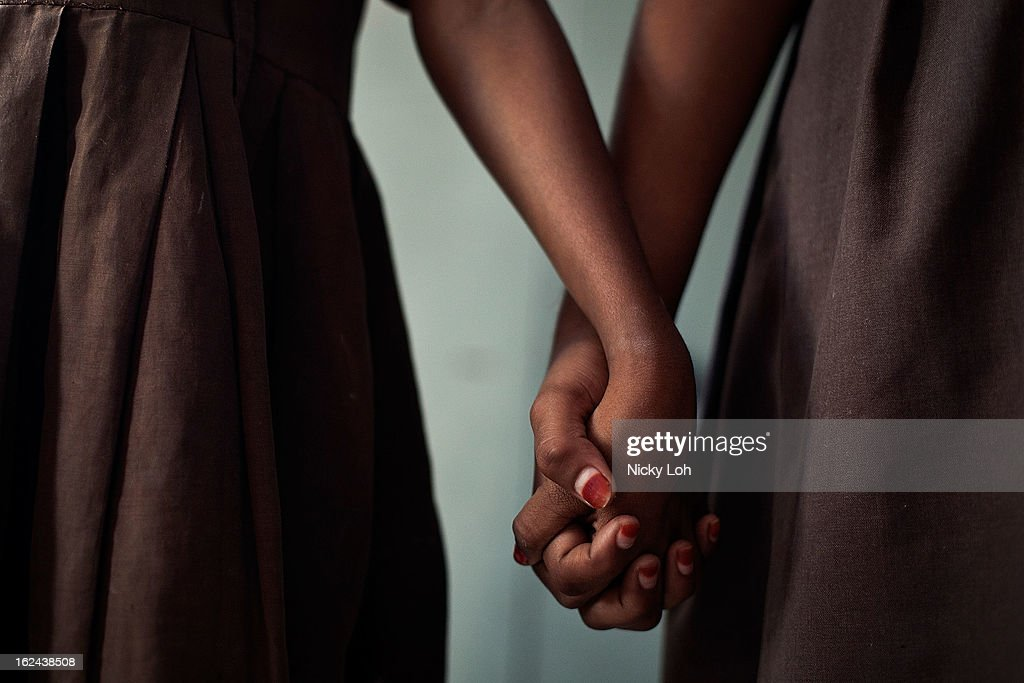 Students hold hands during classes at the Aarti Home shelter on February 21, 2013 in Kadapa, India. Female infanticide is still prevalent in rural areas of India. The abuse of the dowry tradition has been one of the main reasons for sex-selective abortions and female infanticides in India.