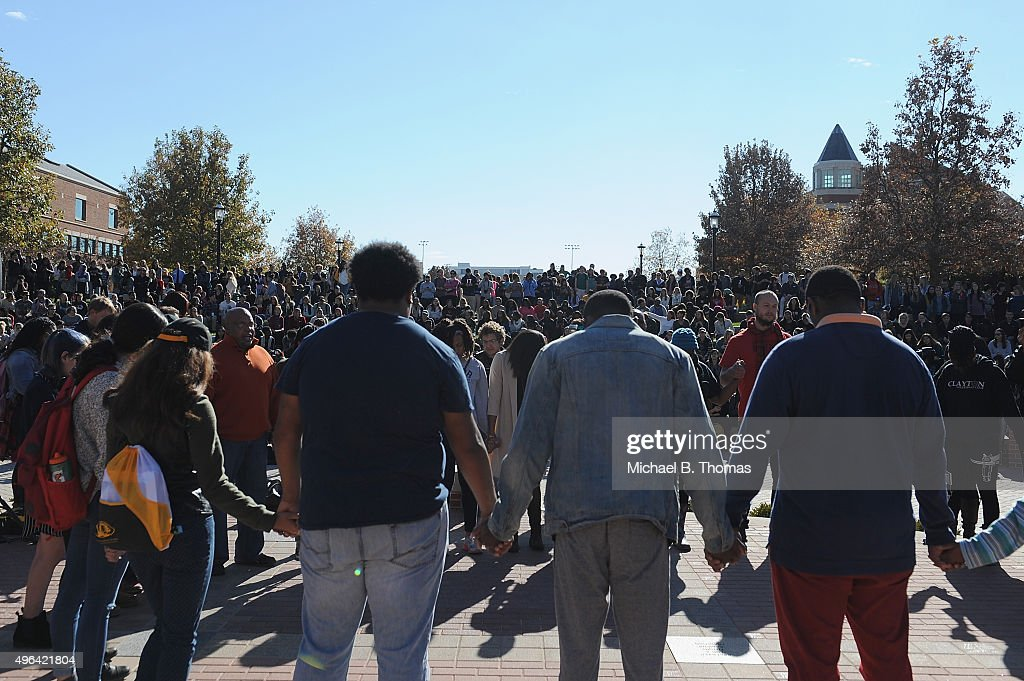 Students hold hands in a word or prayer on the campus of University of Missouri Columbia on November 9 2015 in Columbia Missouri Students celebrate...