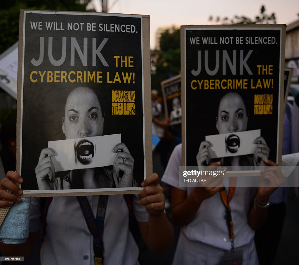 Students hold placards at a protest against the cybercrime law in front of the Supreme court in Manila on February 5, 2013, after the high court again stopped the government from enforcing a controversial cybercrime law. The Philippine Supreme Court has again stopped the government from enforcing a controversial cybercrime law, officials said February 5, amid concern it would severely curb Internet freedoms.