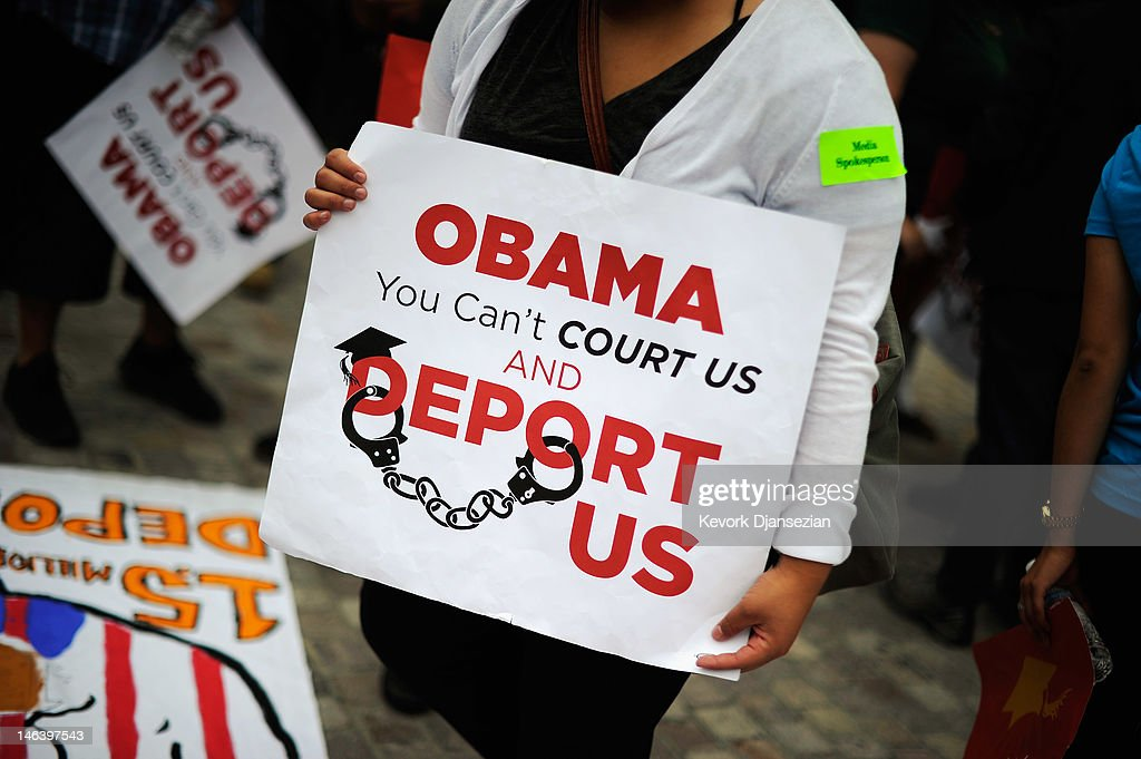 Students hold sign during a demonstration by immigrant student for an end to deportations and urge relief by governmental agencies for those in deportation proceedings on June 15, 2012 in Los Angeles, California. In a policy change, the Obama administration said it will stop deporting young illegal immigrants who entered the United States as children if they meet certain requirements.