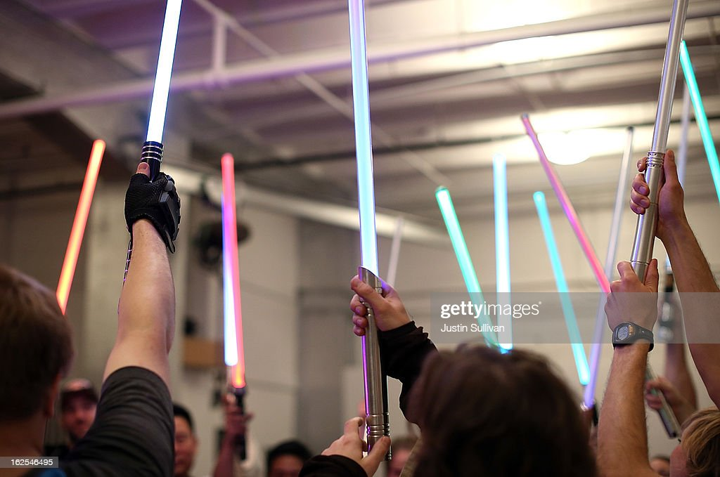 Students hold up their lightsabers during a Golden Gate Knights class in saber choreography on February 24 2013 in San Francisco California Star Wars...