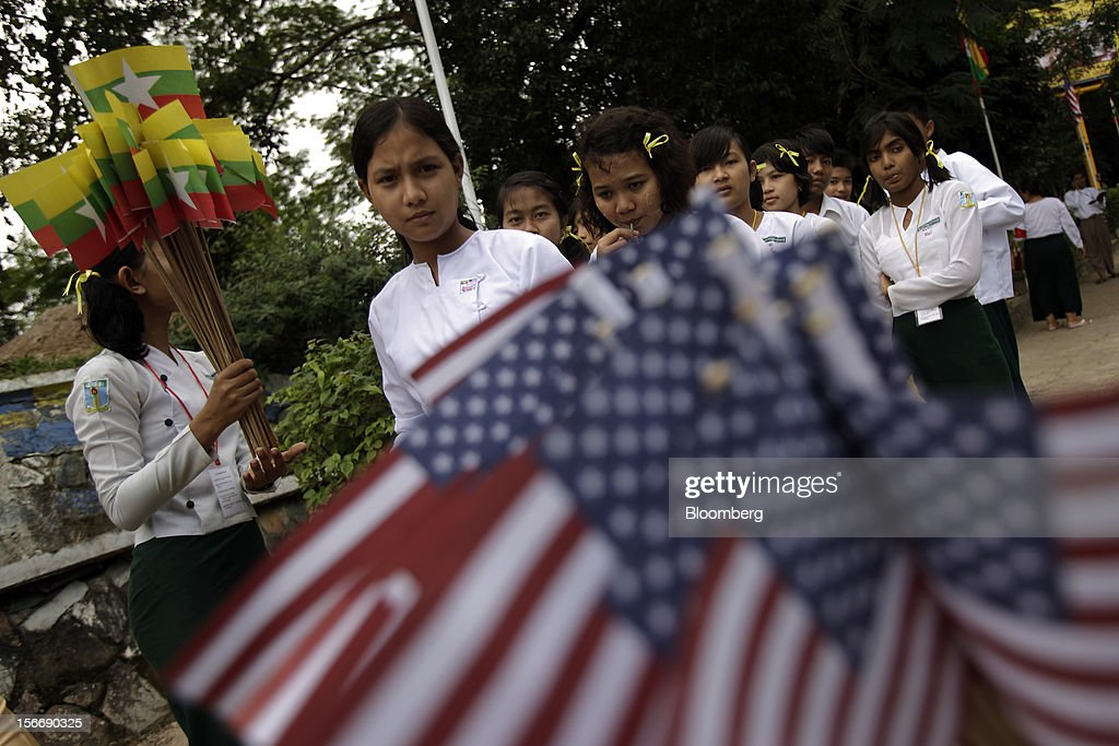 Students hold U.S. and Myanmar flags to welcome U.S. President Barack Obama at Yangon International Airport in Yangon, Myanmar, on Monday, Nov. 19, 2012. Obama hailed Myanmar's shift to democracy and urged more steps to increase freedom in the first visit to the former military regime by a U.S. president. Photographer: Dario Pignatelli/Bloomberg via Getty Images