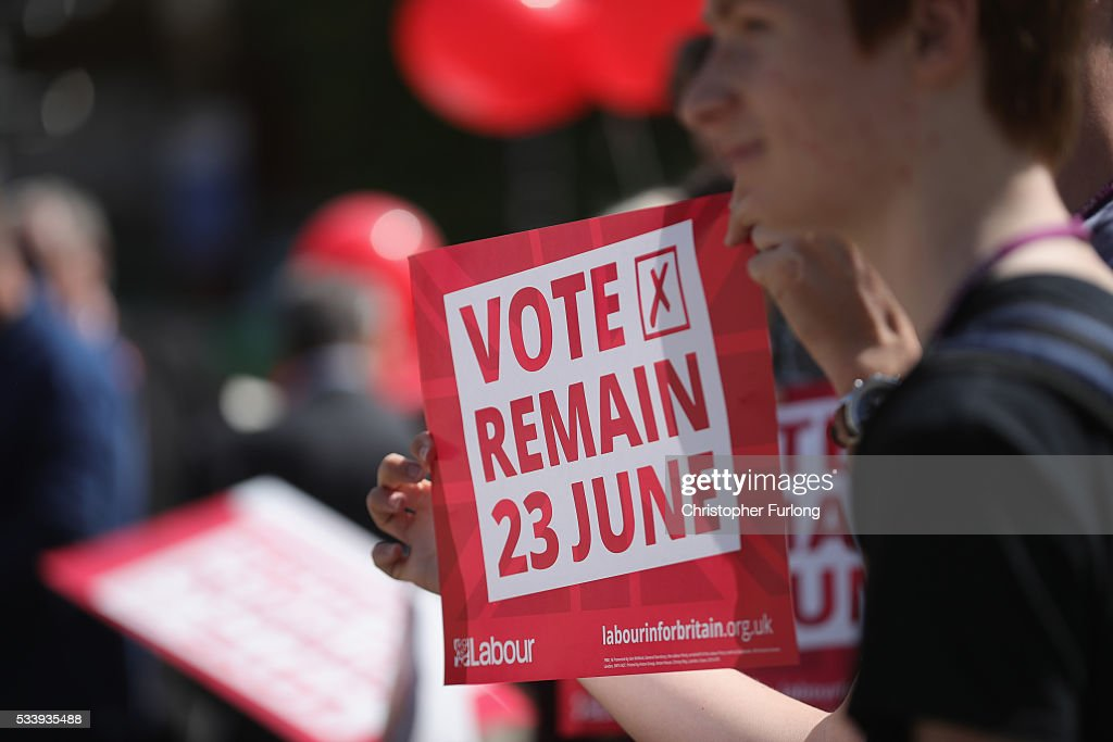 Students hold 'Vote Remain' posters as former Labour leader Ed Miliband campaigns for remain votes while touring with the 'Labour In Battle Bus' at Flag Market on May 24, 2016 in Preston, England. The 'Labour In' campaign is hoping to persuade UK citizens to stay in the European Union when they vote in the EU Referendum on the June 23.