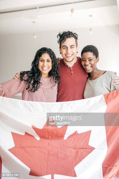 Students holding Canadian flag
