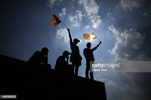UNAM students holds up flags during a protest around the university campus demanding respect for the autonomy of the institution on November 16 2014...