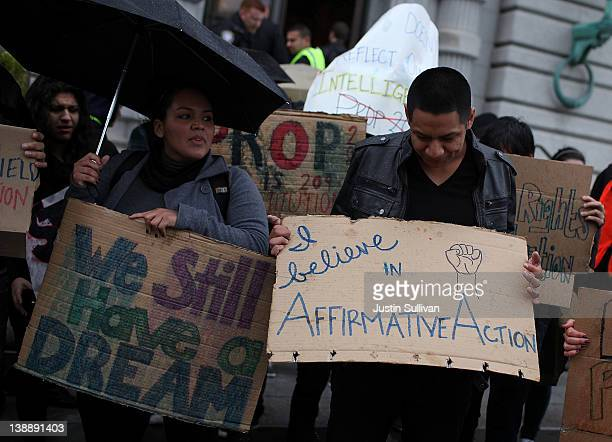 Students hoping for a repeal of California's Proposition 209 hold signs as they protest outside of the Ninth US Circuit Court of Appeals on February...