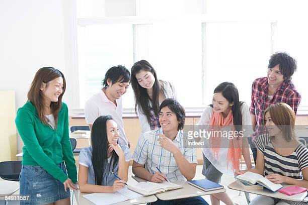 Students in classroom, smiling