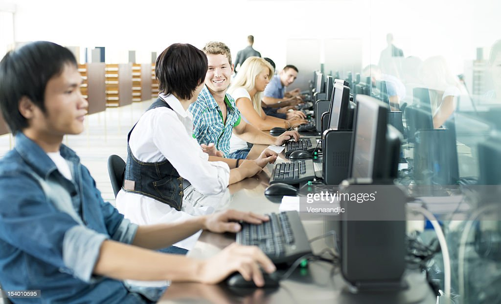 Students in computer room : Stock Photo