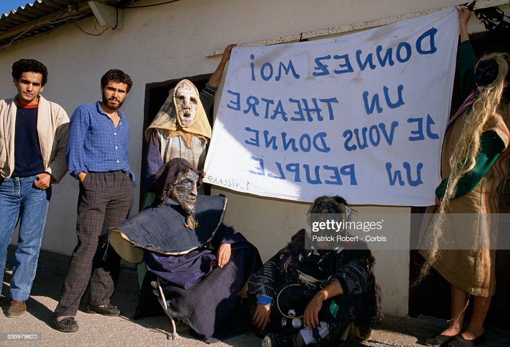 Students in costumes hold a large banner reading 'DONNEZ MOI UN THEATRE JE VOUS DONNE UN PEUPLE' during a student meeting at Bab-Ezzouar University in the suburbs of Algiers. Only a month before, in October 1988, hundreds of protesters, many of them students, were killed during anti-government riots.
