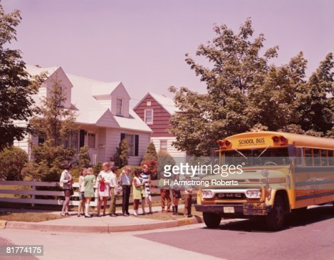 Students in line, waiting to board school bus. (Photo by H. Armstrong Roberts/Retrofile/Getty Images) : Stock Photo