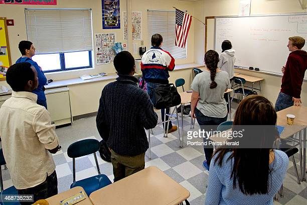 Students in the homeroom of Will Leque a mathematics teacher at Westbrook High School recite the Pledge of Allegiance before the start of school on...