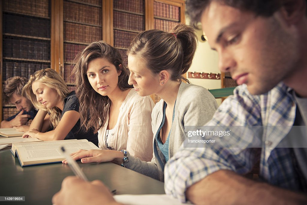 Students in the library studying together : Stock Photo