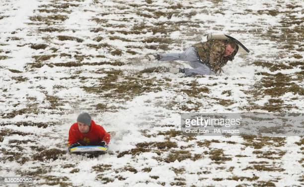 Students in Winchester sledging and crashing down the side of St Catherine's Hill in Winchester after heavy snowfall