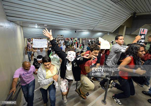 Students invade a subway station during a protest calling for a public transport free pass in the Federal District on June 19 2013 in Brasilia...