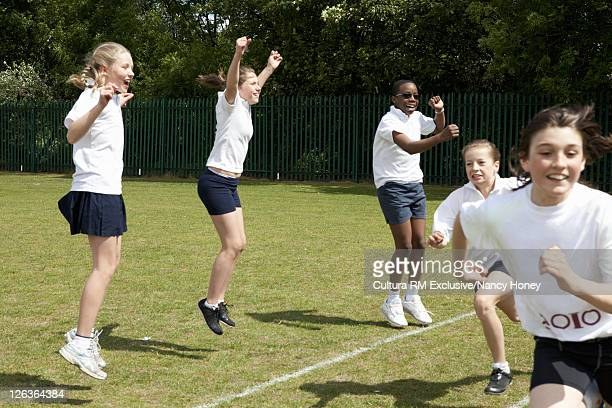 Students jumping for joy in P.E. class