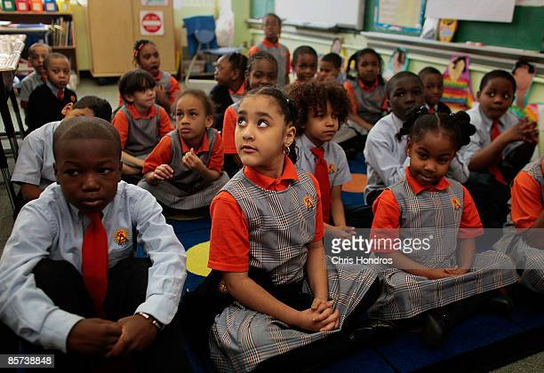 Students Lamine Cisse Marjery Pacheco and Mia McNair sit quietly and wait for their teacher at Harlem Success Academy a free public elementary...