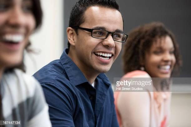 Students laughing in classroom