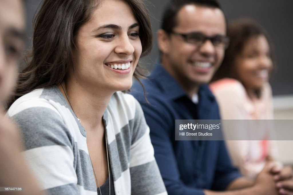 Students laughing in classroom : Stock Photo