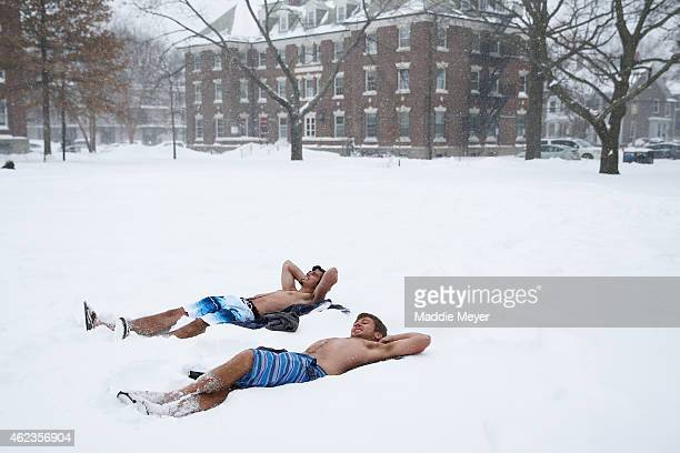 Students lay out in their bathing suits on the Quad on the campus of Harvard University on January 27 2015 in Cambridge Massachusetts Boston and much...