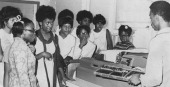 Students learn about Computers at the Eastern High School with an IBM 402 teletype computer Baltimore Maryland 1965