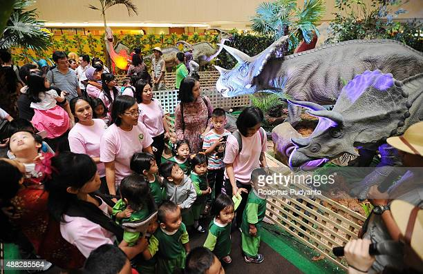 Students learn in the Dinosaur Adventure and Learning Experience Park at Tunjungan Plaza on September 15 2015 in Surabaya Indonesia The dinosaur park...