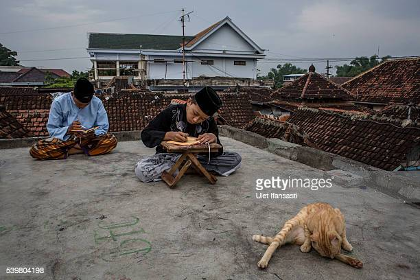 Students learn Islamic scriptures on the roof top in the islamic boarding school Lirboyo during the holy month of Ramadan on June 9 2016 in Kediri...