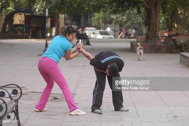Students learn the Israeli self defence technique known as Krav Maga at a school run by Vikky Kapoor in New Delhi India