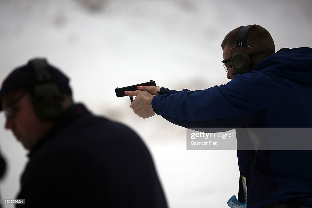 Students learn to fire their pistols at a class taught by King 33 Training at a shooting range on February 24, 2013 in Wallingford, Connecticut. King 33 Training, a company that trains and educates individuals on the safe and proper use of guns and other uses of protective force, offers classes to marksmen of all levels. The Connecticut company offers training for clients interested in maintaining a safe environment for themselves, their families, and those around them. Connecticut, home to a number of gun manufactures including Colt Defense, is a state with conflicting views on guns and gun ownership. Currently the state has some of the strictest gun control laws in the nation and its current governor Daniel Malloy is pushing for tougher measures following the shootings at the Sandy Hook School.